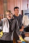 Mid adult couple cleaning the kitchen Stock Photo - Premium Rights-Managed, Artist: Kablonk! RM, Code: 842-03199575