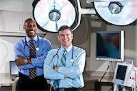 Multi-ethnic doctors in hospital examining room Stock Photo - Premium Rights-Managednull, Code: 842-03199717