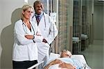 Multi-ethnic doctors standing with patient in hospital Stock Photo - Premium Rights-Managed, Artist: Kablonk! RM, Code: 842-03199731