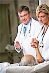 Doctors with patient in hospital room Stock Photo - Premium Rights-Managed, Artist: Kablonk! RM, Code: 842-03199735