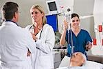Doctors and nurse in hospital room with patient Stock Photo - Premium Rights-Managed, Artist: Kablonk! RM, Code: 842-03199743