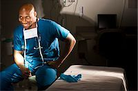 Portrait of African American doctor in scrubs sitting in hospital room Stock Photo - Premium Rights-Managednull, Code: 842-03199762