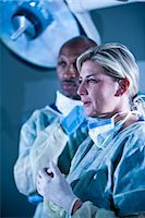 Multi-ethnic doctors in surgical scrubs in hospital room Stock Photo - Premium Rights-Managednull, Code: 842-03199781