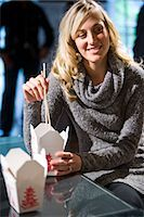 Young woman eating Chinese take-out at home Stock Photo - Premium Rights-Managednull, Code: 842-03199996