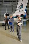 Three airplane mechanics standing next to small planes in hangar Stock Photo - Premium Rights-Managed, Artist: Kablonk! RM, Code: 842-03200205