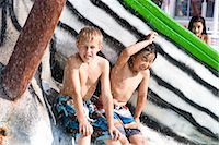 Two boys getting wet at water park in summer Stock Photo - Premium Rights-Managed, Artist: Kablonk! RM, Code: 842-03200301