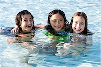 Three happy young girls in swimming pool Stock Photo - Premium Rights-Managednull, Code: 842-03200333