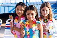 Girls with lollipops and flower leis on pool deck in summer Stock Photo - Premium Rights-Managednull, Code: 842-03200337