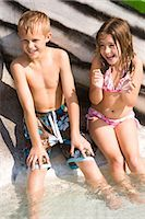 Two children having fun in pool at water park in summer Stock Photo - Premium Rights-Managednull, Code: 842-03200343