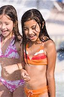 Two young girls arm in arm at water park Stock Photo - Premium Rights-Managednull, Code: 842-03200351