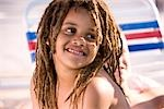 Close-up of happy young African American boy smiling on pool deck Stock Photo - Premium Rights-Managed, Artist: Kablonk! RM, Code: 842-03200370