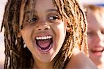 Close-up of happy young African American boy grinning on pool deck Stock Photo - Premium Rights-Managed, Artist: Kablonk! RM, Code: 842-03200373