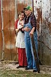 Senior couple standing outside weathered barn Stock Photo - Premium Rights-Managed, Artist: Kablonk! RM, Code: 842-03200541