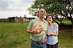 Senior couple standing in field of rural home Stock Photo - Premium Rights-Managed, Artist: Kablonk! RM, Code: 842-03200565