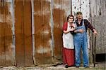 Senior couple standing outside weathered barn Stock Photo - Premium Rights-Managed, Artist: Kablonk! RM, Code: 842-03200592