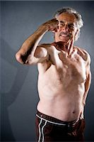Senior man flexing muscles, studio shot Stock Photo - Premium Rights-Managednull, Code: 842-03200681
