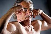 Senior man flexing muscles, studio shot Stock Photo - Premium Rights-Managednull, Code: 842-03200682
