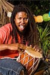 Portrait of young Jamaican man with dreadlocks playing bongo on tropical island Stock Photo - Premium Rights-Managed, Artist: Kablonk! RM, Code: 842-03200816