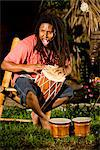 Young Jamaican man with dreadlocks playing bongos on tropical island Stock Photo - Premium Rights-Managed, Artist: Kablonk! RM, Code: 842-03200833