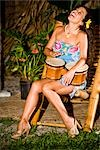 Young Hispanic woman playing bongo drums on tropical island Stock Photo - Premium Rights-Managed, Artist: Kablonk! RM, Code: 842-03200835