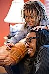 Jamaican father and son with dreadlocks at home Stock Photo - Premium Rights-Managed, Artist: Kablonk! RM, Code: 842-03200919