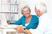 Happy senior couple using laptop Stock Photo - Premium Royalty-Freenull, Code: 628-03201179
