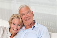 Happy senior couple on sofa Stock Photo - Premium Royalty-Freenull, Code: 628-03201187