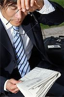 sweaty businessman - Businessman holding glasses and paper Stock Photo - Premium Rights-Managednull, Code: 849-03202649