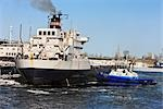 Tug Boat and Laker Ship in Harbour, Montreal, Quebec, Canada Stock Photo - Premium Rights-Managed, Artist: Jean-Yves Bruel, Code: 700-03210449