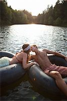 Young Couple Floating on Inner Tubes on the Lake, Near Portland, Oregon, USA Stock Photo - Premium Royalty-Freenull, Code: 600-03210550