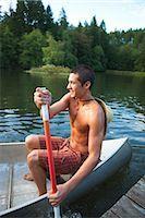 Teenage Boy Canoeing, Near Portland, Oregon, USA Stock Photo - Premium Royalty-Freenull, Code: 600-03210555