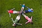Children Lying in Circle on Grass Stock Photo - Premium Rights-Managed, Artist: Ty Milford, Code: 700-03210505
