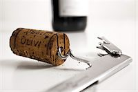 Close-up of cork and corkscrew Stock Photo - Premium Rights-Managednull, Code: 853-03227651