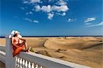 Woman sitting on a fence looking at the sand dunes, Maspalomas, Gran Canaria, Spain Stock Photo - Premium Rights-Managed, Artist: F1Online, Code: 853-03227826