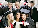 Graduates holding diplomas Stock Photo - Premium Royalty-Freenull, Code: 635-03228723