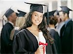 Smiling graduate holding diploma Stock Photo - Premium Royalty-Freenull, Code: 635-03228739