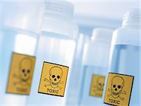 poison - Bottles with toxic labels Stock Photo - Premium Royalty-Freenull, Code: 635-03229109