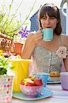 Woman Having Breakfast Outdoors Stock Photo - Premium Rights-Managed, Artist: Klick, Code: 700-03229386