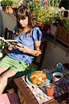 Woman Reading Book Outdoors Stock Photo - Premium Rights-Managed, Artist: Klick, Code: 700-03229400