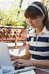 Woman Using Laptop Computer Stock Photo - Premium Rights-Managed, Artist: Klick, Code: 700-03229401