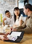 Friends Paying Bill at Wine Bar, Toronto, Ontario, Canada Stock Photo - Premium Royalty-Free, Artist: Matthew Plexman, Code: 600-03230239