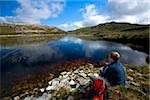 Aghla Mountain, Co Donegal, Ireland;  Man resting beside a mountain pool Stock Photo - Premium Rights-Managed, Artist: IIC, Code: 832-03233713