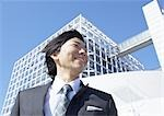 Businessman looking up Stock Photo - Premium Royalty-Free, Artist: Peter Griffith, Code: 670-03234446