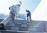 Businessmen running up stairs Stock Photo - Premium Royalty-Free, Artist: Albert Normandin, Code: 670-03234449