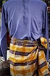 Closeup of baju melayu, traditional Malay attire for men.