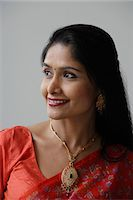 singapore traditional costume lady - Head shot of Indian woman wearing a sari and smiling Stock Photo - Premium Royalty-Freenull, Code: 655-03241611