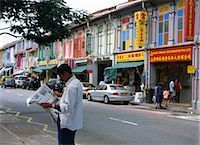 An Indian man reading newspaper on the street at Little India, Singapore Stock Photo - Premium Rights-Managednull, Code: 855-03253807