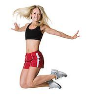 female white background full body - Person leaping in the air Stock Photo - Premium Royalty-Freenull, Code: 640-03255587