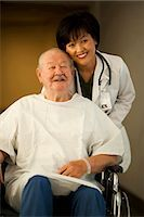 Female doctor with mature man in wheelchair Stock Photo - Premium Royalty-Freenull, Code: 640-03255814