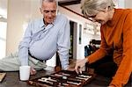 Mature couple playing backgammon Stock Photo - Premium Royalty-Free, Artist: AWL Images, Code: 640-03255863